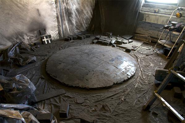 Alejandra Prieto, Studio view with Convex Coal Mirror (coal, 72 x 72 x 8 inches) on floor