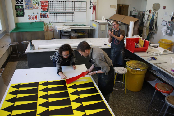 Artist James Siena working at the press with assistant Amelia Jones and master printer Tom Reed at Island Press